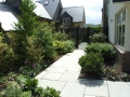 4-patio-paving-natural-stone-pathway-planting-timber-trellis-painted-indian-sandstone-hedging-landscaping-company-landscape-gardener-design-east-sussex-after 4