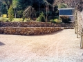 natural-stone-wall-raised-beds-terracing-planting-trees-flower-garden-design-gravel-landscaper-driveway-pebble-front-design-landscaping-company-landscape-gardener-surrey