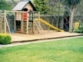 timber-decking-deck-paving-pathway-natural-stone-wall-grass-turf-lawn-landscaper-children-childres-play-area-jungle-gym-feature-garden-landscaping-company-landscape-gardener-south-london