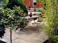 patio-paving-natural-stone-indian-sandstone-brick-step-wall-planting-trees-bamboos-garden-dining-landscaping-company-landscape-gardener-kent