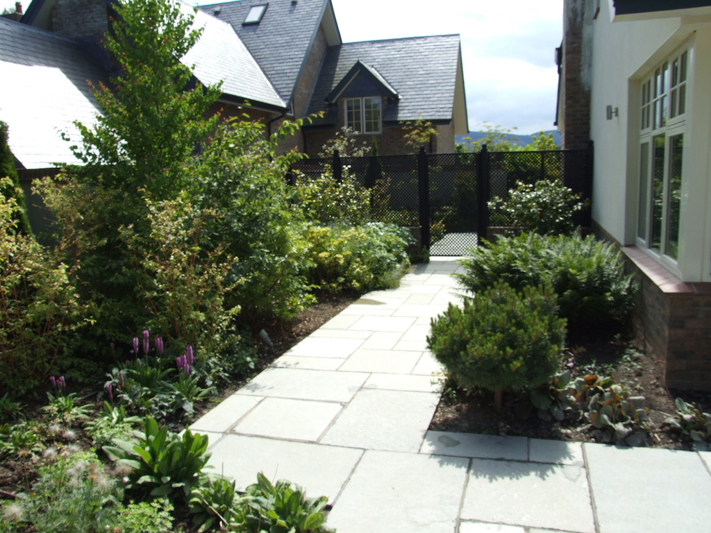patio-paving-natural-stone-pathway-planting-timber-trellis-painted-indian-sandstone-hedging-landscaping-company-landscape-gardener-design-east-sussex