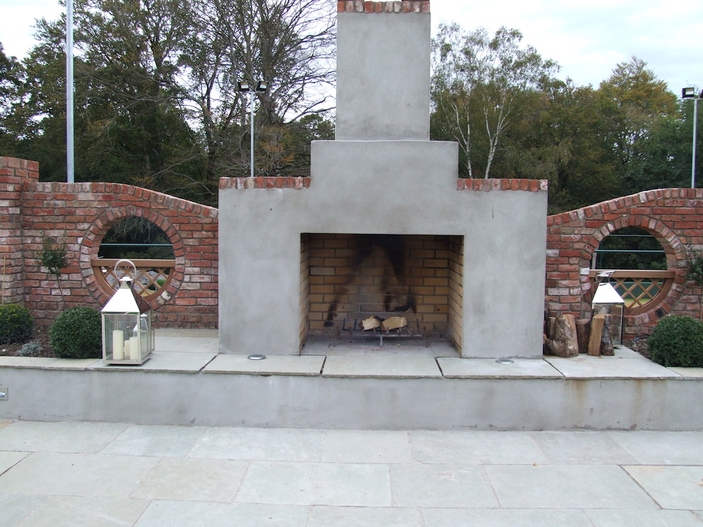 outdoor-fireplace-garden-fire-feature-paving-patio-natural-stone-brick-wall-timber-work-landscaper-garden-landscape-landscaping-company-gardener-landscaped-design-sussex