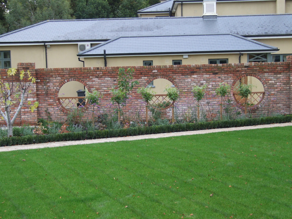 4-brick-feature-wall-capping-timber-work-planting-hedging-trees-drainage-pathway-turf-lawn-grass-garden-landscapers-landscape-gardener-landscaping-company-manicured-sussex