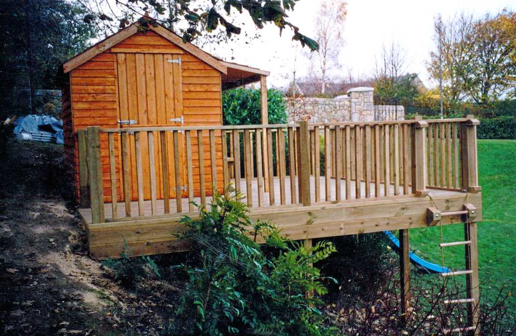 children-childrens-play-area-house-wooden-shed-raised-deck-timber-decking-balustrade-garden-planting-grass-lawn-tree-hand-rail-landscapers-landscape-gardener-landscaping-company-south-london