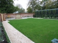 walled-garden-private-trees-planting-box-hedging-brick-wall-water-feature-gravel-pebble-path-lawn-turf-grass-timberwork-landscaper-timber-landscaping-company-landscape-gardener-garden-design-sussex