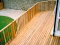 timber-deck-decking-balustrade-hand-rail-garden-lawn-paving-cedar-patio-natural-stone-landscaper-grass-turf-manicured-landscape-gardener-landscaping-company-south-london